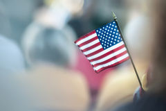 Mini american flag. Mini americn flag held in childs hand royalty free stock photos