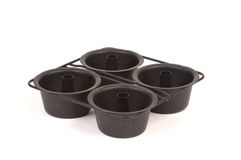 Mini angel food cake pans. Mini angel cake pans for making small angel food cakes for individual servings.  Four pans are connected together Stock Images