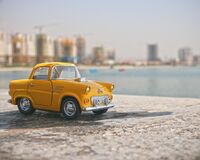 Mini antique yellow taxi cab photo Royalty Free Stock Photography