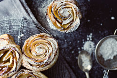 Mini apple roses puff pastry with icing sugar. Royalty Free Stock Photos