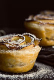 Mini apple roses puff pastry with icing sugar. Stock Photography