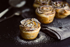 Mini apple roses puff pastry with icing sugar. Stock Images