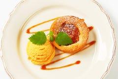 Mini apple tart with ice cream. Mini apple tart with scoop of ice cream Stock Photos