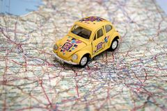 Mini auto on a map Royalty Free Stock Photos