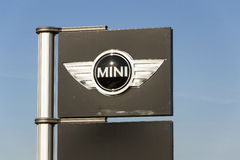Mini automotive marque logo in front of dealership building on March 31, 2017 in Prague, Czech republic. PRAGUE, CZECH REPUBLIC - MARCH 31: Mini automotive Royalty Free Stock Photos