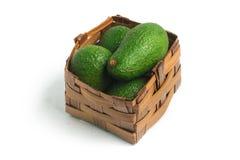 Mini Baby Avocado em uma cesta fotos de stock royalty free