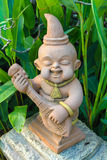 Mini baby  statuary. In the garden Royalty Free Stock Images