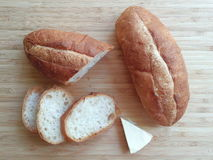 Mini baguette and cheese. Serve on wood chopping board Stock Images