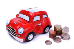 Mini bank. English money with a mini car piggy bank on white background Stock Photos
