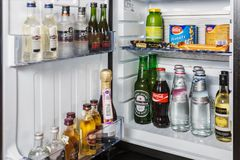 Mini bar with soft drinks, vodka, wine and beer in the hotel ro Stock Photos