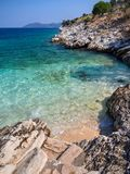 Mini beach and flip flops with a beautiful view on the island of Kefalonia in the Ionian Sea in Greece stock images