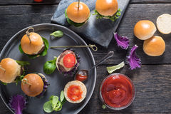 Mini beef burgers from above Stock Photography