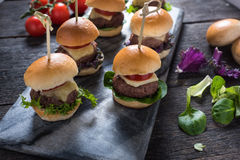 Mini beef burgers,party food Royalty Free Stock Image