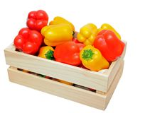 Mini bell pepper in wooden case stock images