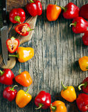 Mini Bell Peppers on wooden background with copy space. stock photography