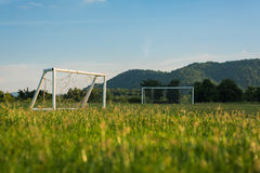 Mini and big soccer goal in the field. Selective Focus. Stock Photos