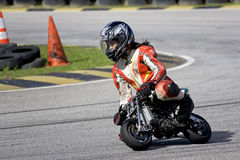 Mini Bike Championship Action - Girl Racer Stock Image