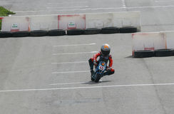 Mini bikes racing circuit. A young mini bike rider rides in Palma de Mallorca´s motor circuit during a local mini-bikes competition in the Spanish island of Royalty Free Stock Image