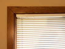 Mini blinds wood window frame Stock Images