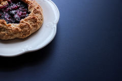 Mini blueberry galettes. Free space for your text Stock Images