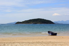 Mini boat. Blue Mini boat on the asia beach stock photos