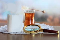 Mini book and magnifying glass on table Royalty Free Stock Photography