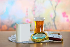 Mini book and magnifying glass on table Stock Photo
