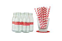 Mini bottle glass. Bottles and red striped paper straws Royalty Free Stock Images