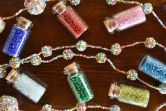 Mini bottles with beads and beaded handicrafts jewellery Royalty Free Stock Photo