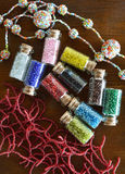 Mini bottles with beads and beaded handicrafts jewellery Stock Photo