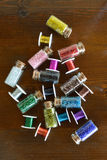 Mini bottles with beads and wire crafts Royalty Free Stock Images