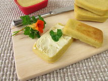 Mini-breads from maize flour with butter royalty free stock image