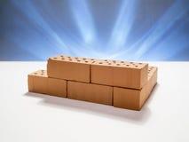 Mini bricks on white background blue illuminated background Royalty Free Stock Photos