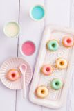 Mini bundt cakes. Iced mini bundt cakes with icing, a tray and a spoon Royalty Free Stock Photo