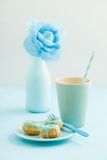 Mini bundt cakes. With icing, a cup of coffee and a crepe paper flower stock photos