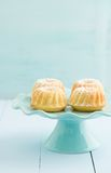 Mini bundt cakes. With icing sugar on a cake stand royalty free stock images