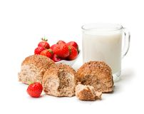 Mini  buns and mug of milk  with strawberries isolated on white b Royalty Free Stock Photos