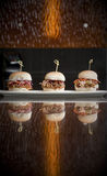 Mini Burger Sandwiches. A trio of Mini Pulled Meat sandwiches on small hamburger or slider buns Stock Images