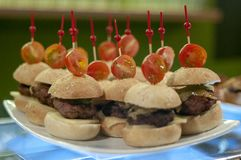Mini burgers with cherry tomato royalty free stock images