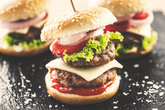 Mini burgers Stock Photos
