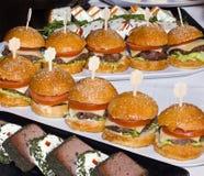 Mini Burgers en fila Imagen de archivo libre de regalías