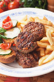 Mini burgers and french fries Royalty Free Stock Images