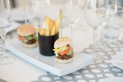 Mini burgers and fries Royalty Free Stock Photography