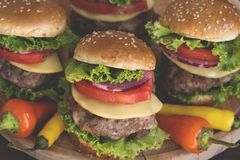 Mini burgers. With chili peppers royalty free stock photos