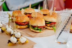 Mini burgers for a party stock photos