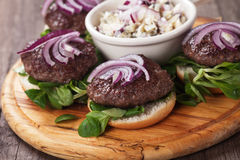 Mini burgers with red onion Royalty Free Stock Image