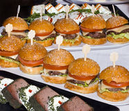 Mini Burgers in a Row Royalty Free Stock Image