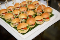 Mini burgers. Serve at party royalty free stock images