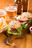 Mini burgers snack with fries and beer Stock Photo