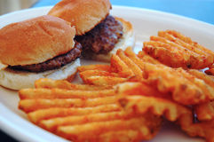 Mini burgers with wavy fries Stock Photo